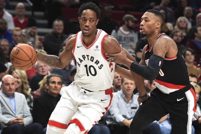 DeMar DeRozan (10) et Damian Lillard.... (Photo Steve Dykes, Associated Press)