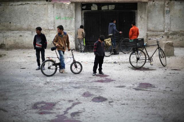 «Un obus tiré par les troupes du régime... (AFP)