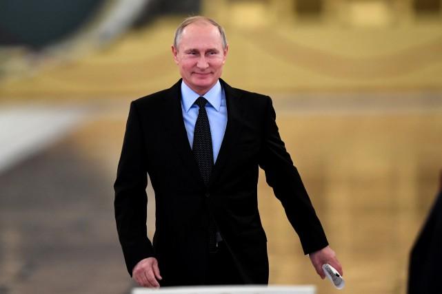 Le président russe Vladimir Poutine, qui devait arriver... (REUTERS)