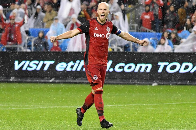Michael Bradley célèbre la qualification du Toronto FC à la... (PHOTO DAN HAMILTON, USA TODAY)
