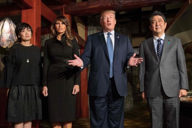 Le président américain Donald Trump, le premier ministre... (Photo JIM WATSON, AFP)