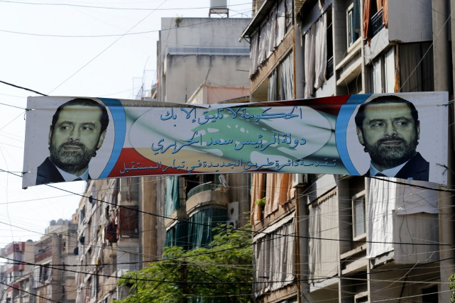 Le premier ministreSaad Hariri (photographié sur l'affiche) a... (PHOTO ANWAR AMRO, AFP)