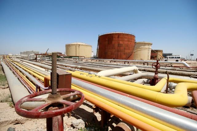 Le rapport annuel de l'OPEP publié mardi prévient... (REUTERS)