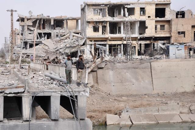 Selon l'agence officielle Sana, l'armée syrienne et ses... (PHOTO AFP)