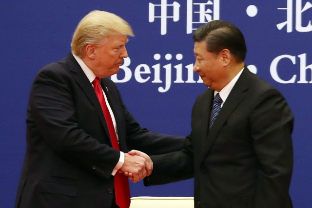 Donald Trump et Xi Jinping... (PHOTO Andrew Harnik, archives AP)