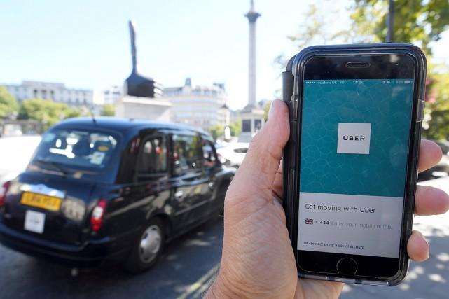 En Grande-Bretagne, les chauffeurs Uber sont rémunérés à... (PHOTO TOBY MELVILLE, ARCHIVES REUTERS)