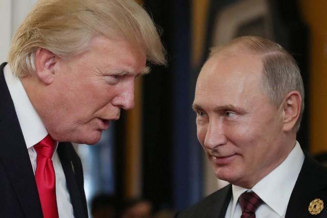 Les présidents russe et américain, Vladimir Poutine et... (Photo Mikhail KLIMENTYEV, AFP)