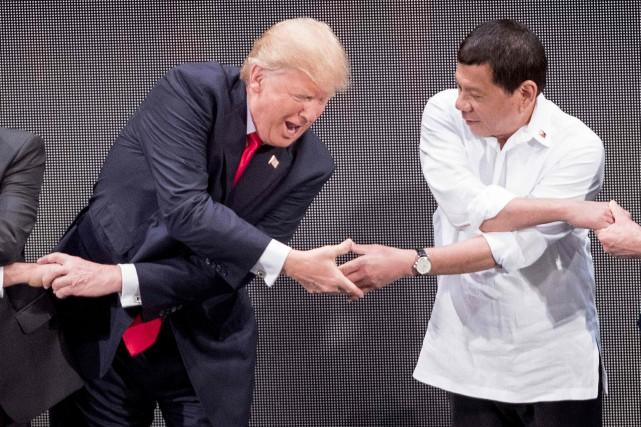 Pendant une conférence de presse, Donald Trump a... (AFP)