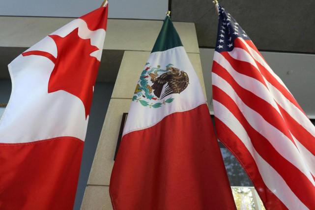 Les négociateurs des trois pays signataires de l'ALENA... (PHOTO Lars Hagberg, archives AFP)