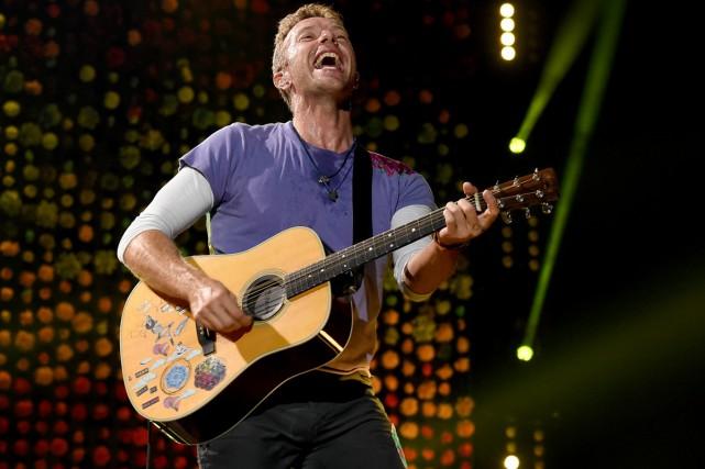 Chris Martin de Coldplay lors d'un spectacle au... (Photo archives AFP)