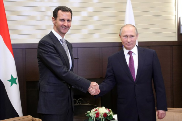 Vladimir Poutine a accueilli mardi son homologue syrien... (PHOTO AFP)
