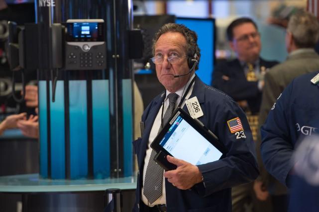 Wall Street a terminé en ordre dispersé lundi, partagée entre la bonne santé... (PHOTO ARCHIVES AGENCE FRANCE-PRESSE)