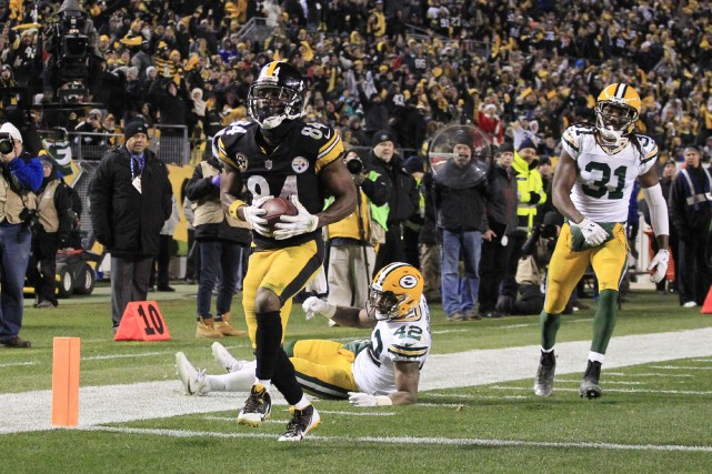 Antonio Brown (84) a capté 10 passes pour des... (Photo Charles LeClaire, USA TODAY Sports)