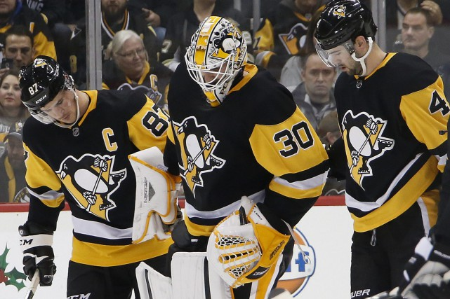 Le gardien des Penguins Matt Murray a quitté... (Photo Gene J. Puskar, AP)