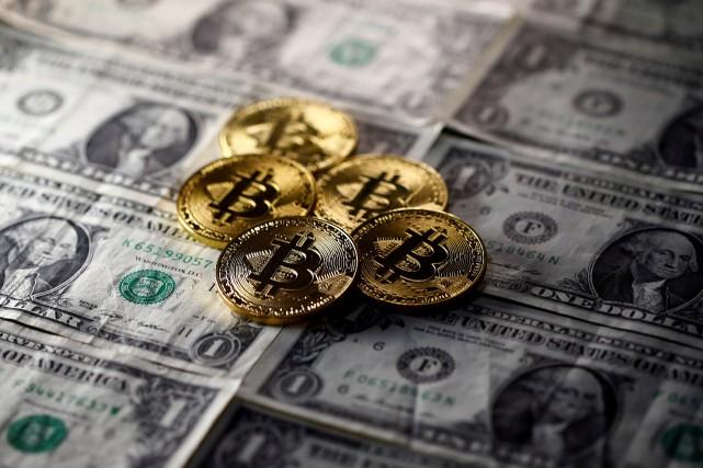 Sans existence physique, le bitcoin lancé en 2009... (PHOTO ARCHIVES REUTERS)