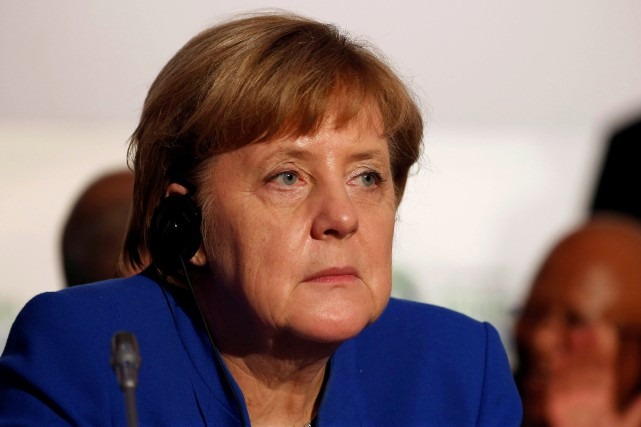 Angela Merkel... (Photo Luc Gnago, REUTERS)