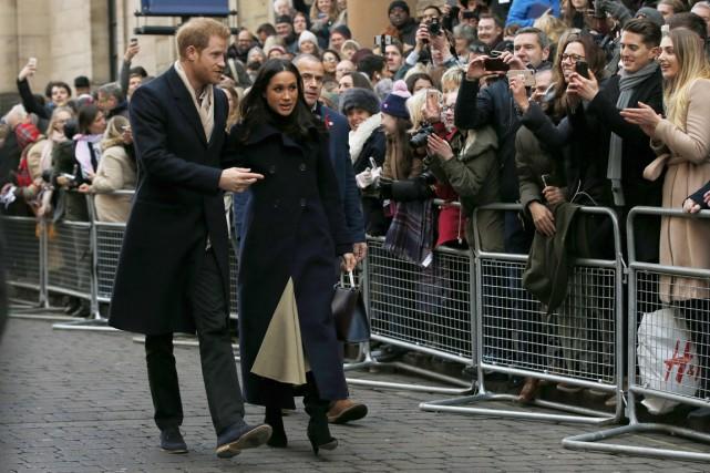 Le déplacement du prince Harry et de sa... (PHOTO ALASTAIR GRANT, ASSOCIATED PRESS)