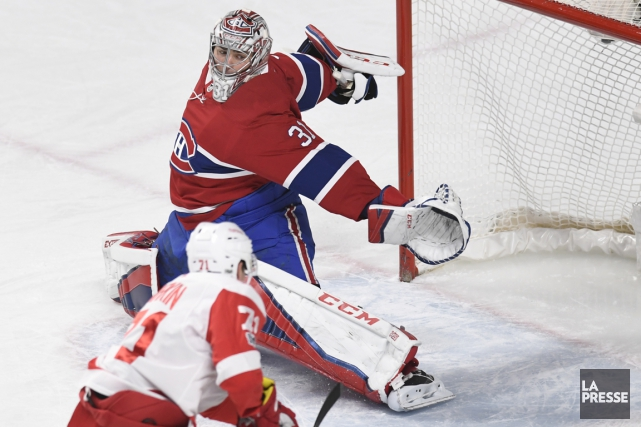 Carey Price bloque le tir de Dylan Larkin... (PHOTO BERNARD BRAULT, ARCHIVES LA PRESSE)