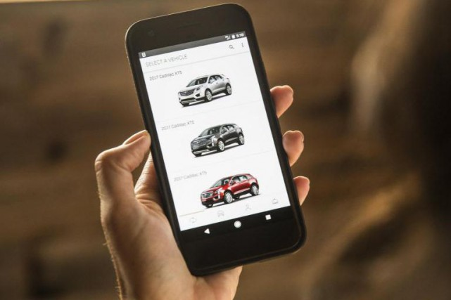 L'application de location de voitures Book by Cadillac... (Photo General Motors)