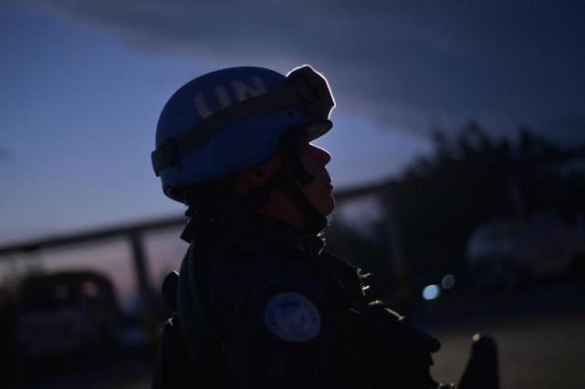 Un autre policier canadien qui prenait part à... (PHOTO AFP)