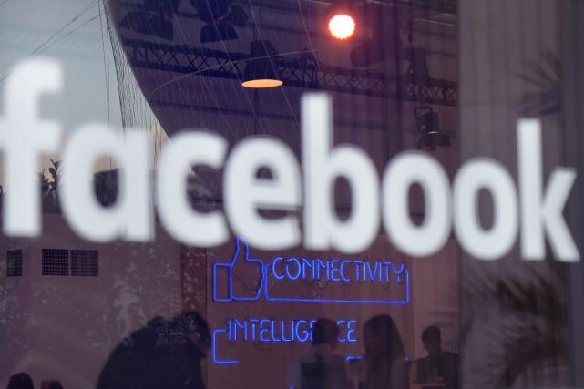 Le réseau social Facebook a réglé à l'amiable... (Photo archives AFP)