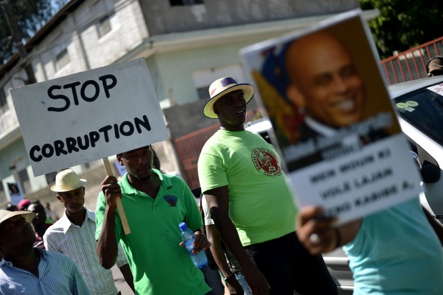 Le président haïtien Jovenel Moïse, élu début2017, affiche... (Photo Hector Retamal, archives Agence France-Presse)