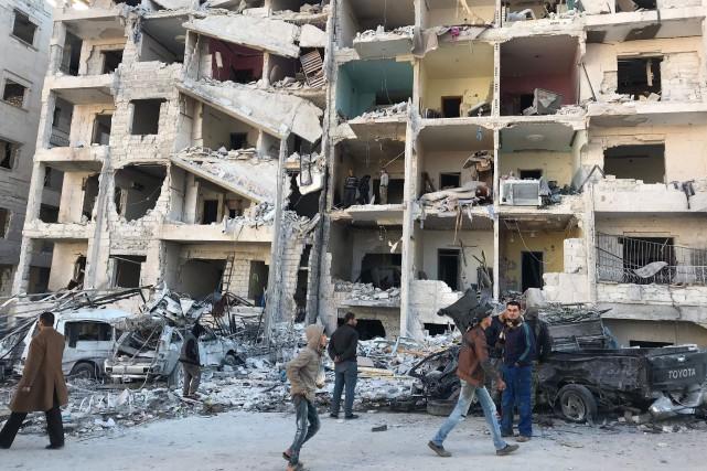 Au moins 21 civils, dont huit enfants, ont... (AFP)