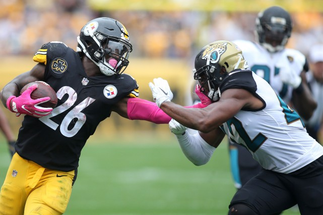 Le'Veon Bell (26) retrouvera sur son chemin Barry... (Photo Charles LeClaire-USA TODAY Sports, USA Today Sports)