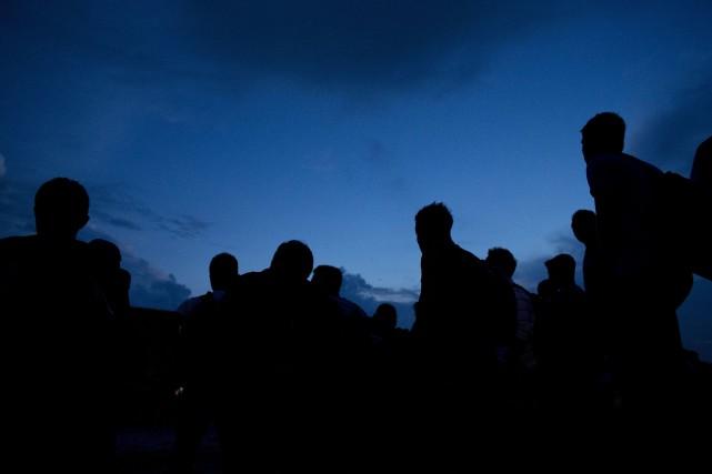Le groupe le plus important, 198 personnes entassées... (AP)