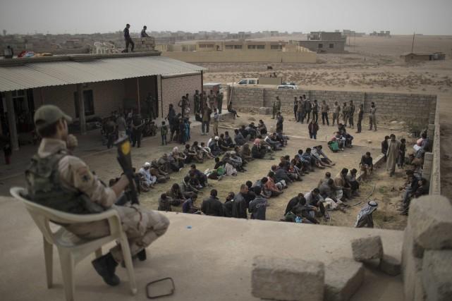 Selon Human Rights watch, des combattants kurdes ont... (Photo archives AP)
