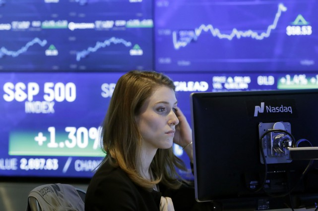 Les marchés profitaient de l'optimisme lié à des... (Photo AP)