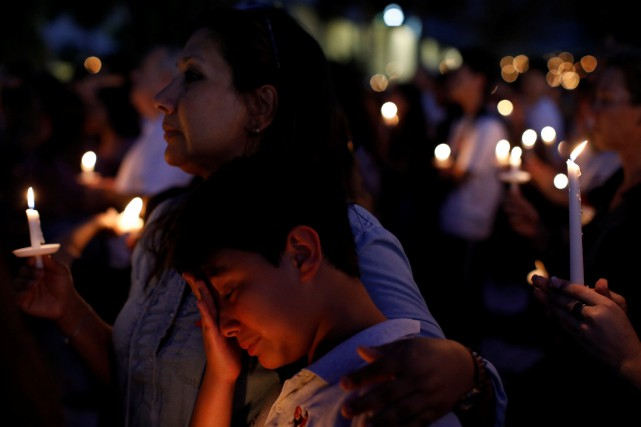 People attend a candlelight vigil for victims of... (REUTERS)