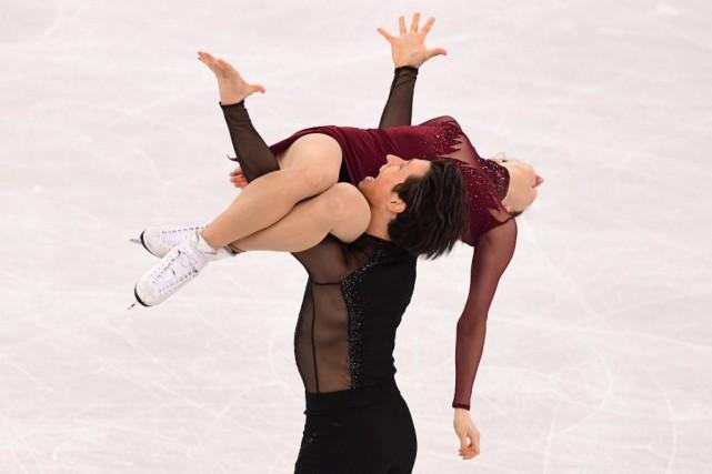Scott Moir et Tessa Virtue ont retiré, puis... (PhotoRoberto SCHMIDT, Agence France-Presse)