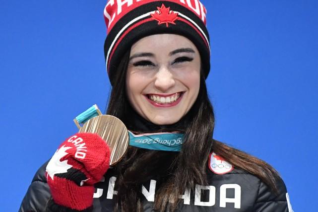 Kaetlyn Osmond (photo) a permis au Canada de... (Photo Dimitar Dilkoff, Agence France-Presse)