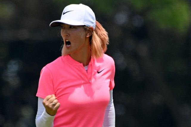 Michelle Wie a fermé son poing en guise de... (PHOTO ROSLAN RAHMAN, AGENCE FRANCE-PRESSE)
