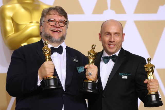 Guillermo del Toro et J. Miles Dale.... (Photo Mike Blake, REUTERS)