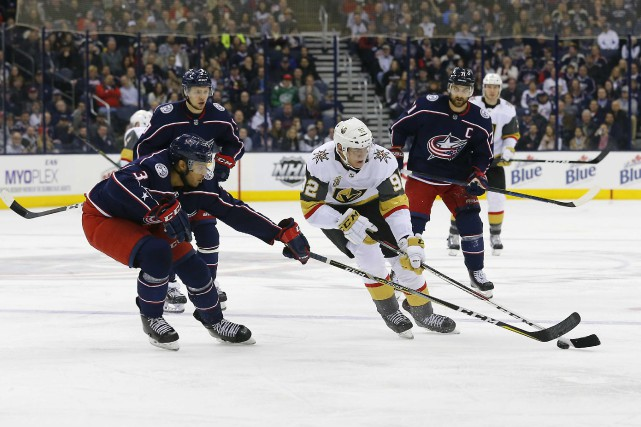 Tomas Nosek (92) et Seth Jones (3)... (Photo Russell LaBounty, USA TODAY Sports)