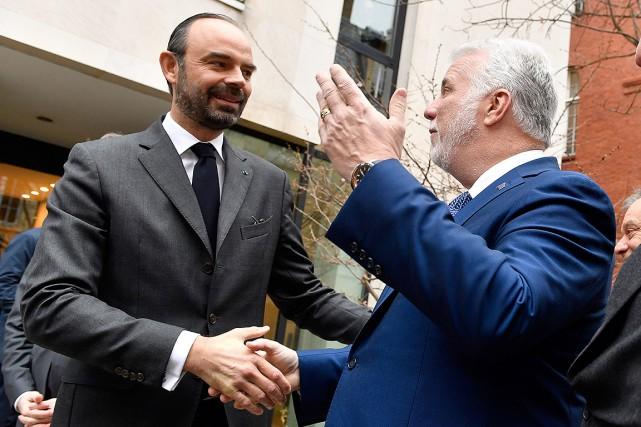 Le premier ministre français Édouard Philippe (à gauche)... (Gerard Julien, Pool Photo via AP)