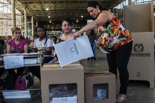 Plus de 36 millions d'électeurs étaient appelés à... (PHOTO AFP)
