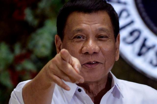 «Je déclare (...) que les Philippines révoquent leur... (REUTERS)