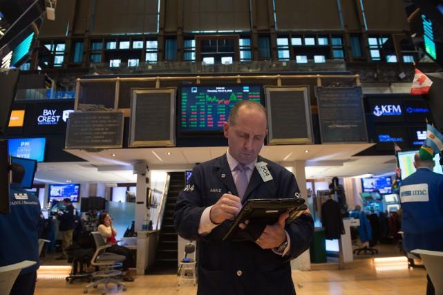 Le Dow Jones Industrial Average, a reculé mercredi... (AFP)