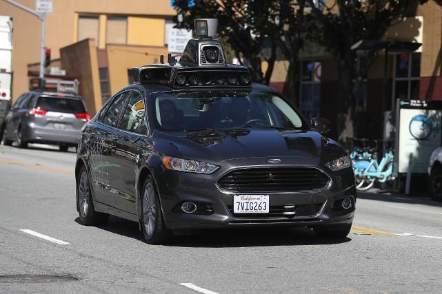 La course vers l'autonomie automobile continue malgré l'accident... (photo AFP)