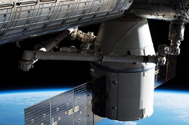 La capsule Dragon arrive à l'ISS le 4... (NASA VIA AP)