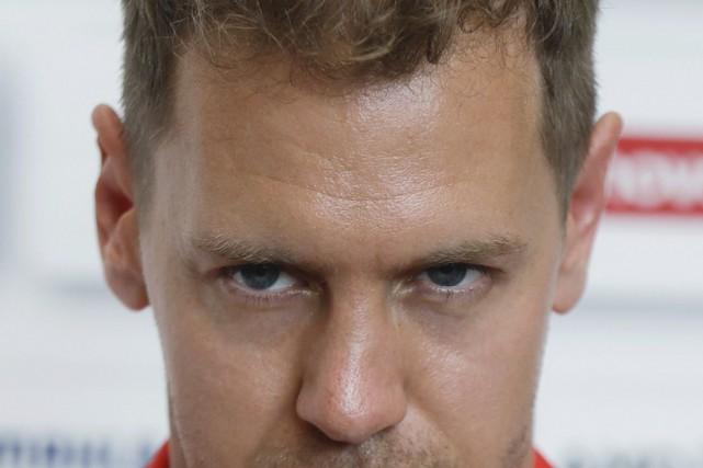 Sebastian Vettel, de Ferrari, a remporté une victoire... (photo AP)