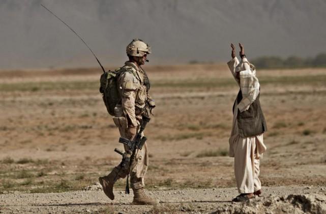 Les gestes répréhensibles qui font l'objet d'une enquête... (PhotoAnja Niedringhaus, Archives Associated Press)