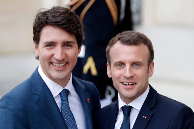 Pendant la conférence de presse avec Emmanuel Macron,... (PHOTO REUTERS)