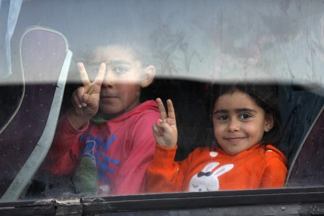 Les évacuations imposées par le régime avaient commencé... (AFP)