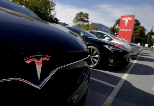 Les propriétaires de Tesla pourront bientôt adhérer «d'un... (photo REUTERS)