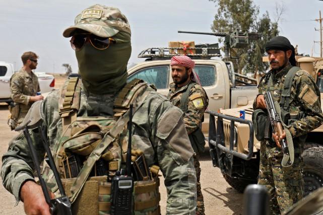 «Nos forces avec celles de la coalition internationale... (Photo Delil Souleiman, Agence France-Presse)