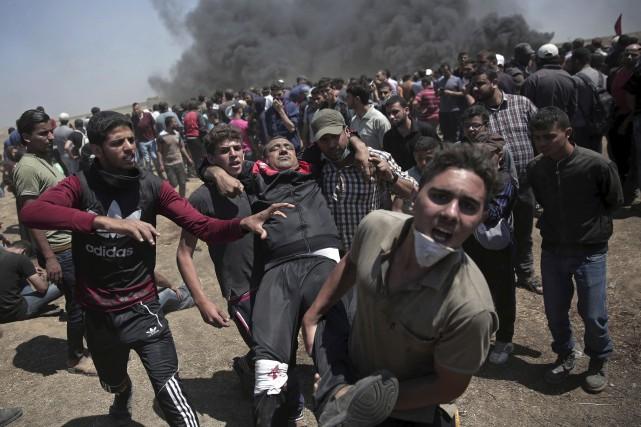 Du fait de ce lourd bilan, cette journée... (Photo Khalil Hamra, Associated Press)